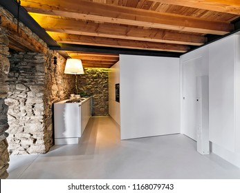 interiors shots of a modern kitchen with concrete floor and the wooden ceiling