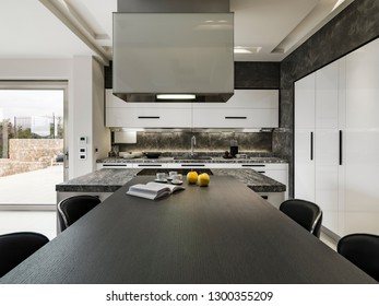 interiors shots of a modern kitchen in foreground the  kitchen isaland