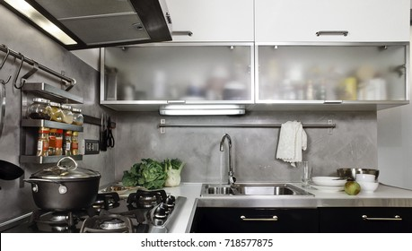 interiors shots of a modern kitchen in the foreground the gas hob and the steel sink