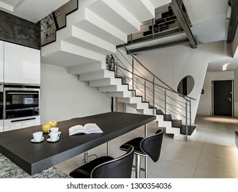 interiors shots of a modern kitchen in the foregroundt he dining table and the forehrounf  the masonry staircase