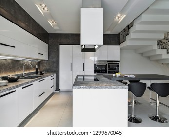 interiors shots of a modern kitchen with kitchen isaland