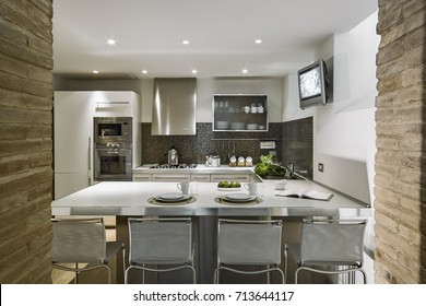 interiors shots of modern kitchen with kitchen island and wood floor