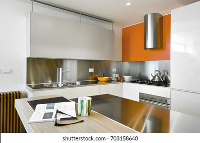 interiors shots of a modern kitchen  with steel hood and kitchen island