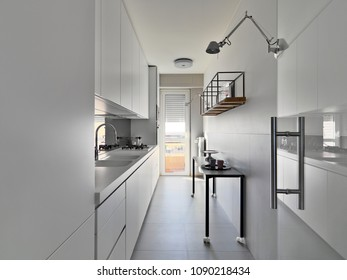 interiors shots of a modern white kitchen with white cabinets