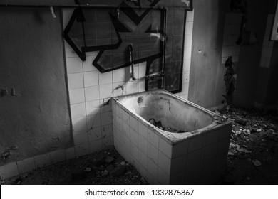 Interiors of Volterra asylum: old bathtub. Ferri pavilion, the judicial psychiatric hospital special area of abandoned asylum of Volterra (manicomio di Volterra), Tuscany, Italy 18/12/2011.