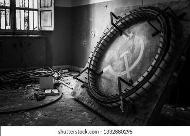 Interiors of Volterra asylum: old communist flag. Ferri pavilion, the judicial psychiatric hospital special area of abandoned asylum of Volterra (manicomio di Volterra), Tuscany, Italy 18/12/2011.