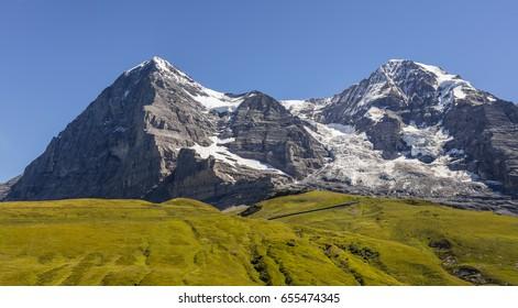 Interlaken, Switzerland - August 23, 2016: From Kleine Scheidegg, Eiger (3,970 m - 13,020 ft) and Moench (4,107 m - 13,474 ft).