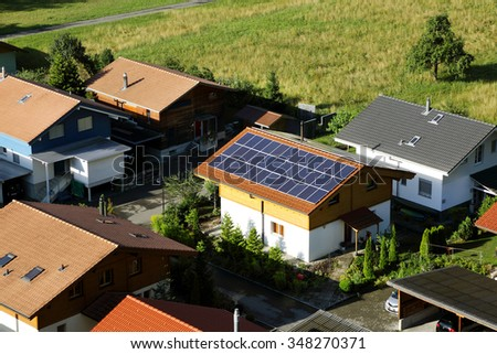 INTERLAKEN, SWITZERLAND - JULY 25:  A house in Interlaken city with solar panels mounted on roof to meet environmental friendly power demands on July 25, 2015, Interlaken, Switzerland