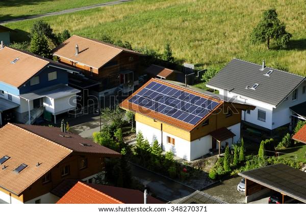 INTERLAKEN, SWITZERLAND - JULY 25:  A house in Interlaken city with solar panels mounted on roof to meet environmental friendly power demands on July 25, 2015, Interlaken, Switzerland