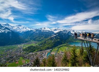 INTERLAKEN, SWITZERLAND - MAY 7, 2019: Breathtaking aerial view over Interlaken and Swiss Alps from Harder Kulm View point