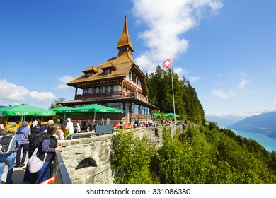 INTERLAKEN, SWITZERLAND - SEPTEMBER 07, 2015: Harder Kulm Panorama Restaurant located high up on mountain at 1322 meters above sea level offers a unique view of the world-famous Alpine peaks
