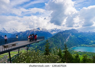 Interlaken, Switzerland-May, 2018. Tourists standing on Harder Kulm view point in a beautiful spring day.