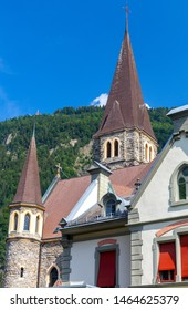 Interlaken. White catholic church with a bell tower on a sunny morning.