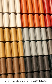 Interlocking Coloured Roof Tiles on display. Replacement roofing. Could be Terracotta roof tiles, concrete tiles, or clay roofing.