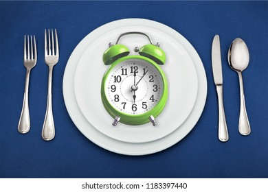 Intermittent fasting concept above breakfast clock delay