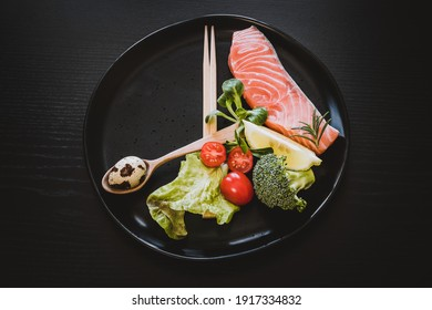 Intermittent fasting method - sixteen hours diet, eight hours eating time. Healthy lifestyle concept. Close-up, copy space, top view.