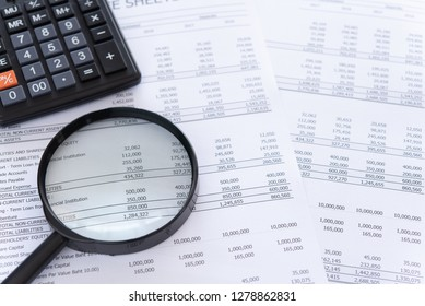 Internal audit, Auditing tax, Analyze economy concept. financial statement annual with calculator, magnifying glass. above view.