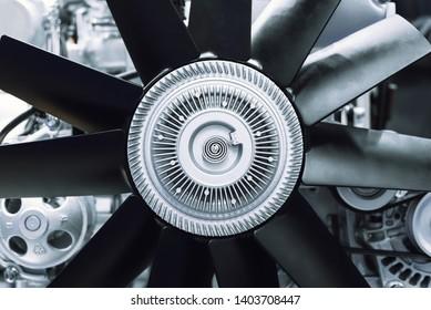 Internal combustion engine automotive, engine fragment close-up Engine cooling fan.