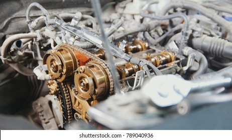 The internal combustion engine, disassembled, repair at car service, overhaul, under the hood of the car
