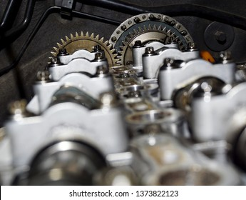 Internal design of car engine with mechanism Intake camshaft ,Exhaust camshaft and Timing chain drive gear in car repair service center. Car engine