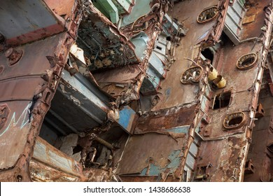 Internal parts of decommissioned marine ship that was cut and left on the shore.