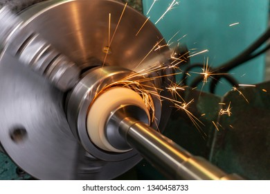 Internal processing of the hole with an abrasive stone on a grinding machine, sparks fly in different directions