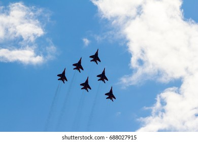"""International Aviation and Space Salon MAKS 2017. Russia,Zhukovsky. 23.07.2017. Aerobatic team """"Strizhi"""" on the MiG-29 fighters"""