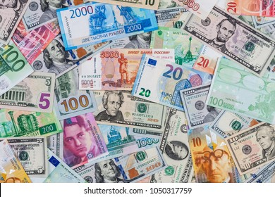 International banknote background for global currencies concept for money exchange business. Money from different countries: dollars, euros, rubles, swiss franks.