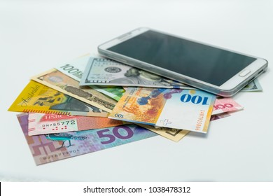 International banknotes in various currencies with the main object of mobile phone for buying or selling online or e-commerce business concept