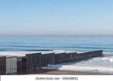 The international border wall extending out into the ocean and separating San Diego, California from Tijuana, Mexico at Border Field State Park, the most Southwesternly location in the United States.