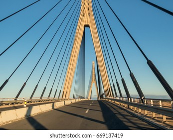 The International bridge, a suspension bridge between Spain and Portugal, looking towards Portugal and the Algarve with Ayamonte, Huelva Province, Andalucia behind crossing the Guadiana river.