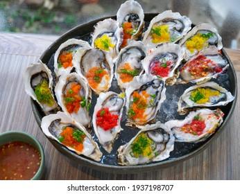International Buffet - Raw oyster with tobiko