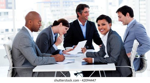 International business people discussing a new strategy in a meeting