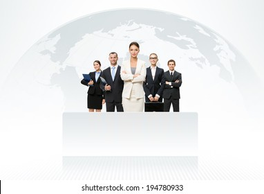 International business team with map of the world in background