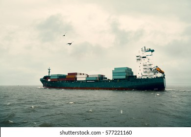 International Container Cargo ship in the Baltic sea in a storm. Image retro vintage filter effect.