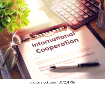 International Cooperation on Clipboard. Composition on Working Table and Office Supplies Around. 3d Rendering. Blurred Toned Illustration.