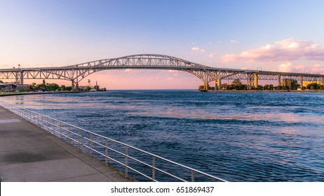 International Crossing. The Blue Water Bridge connects Port Huron, Michigan in the USA and Sarnia, Ontario in Canada. The twins spans of the bridge cross the international waterway the St. Clair River