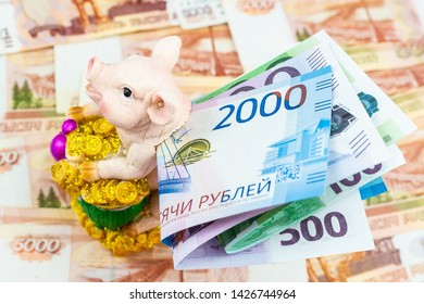 International currencies background. Money from different countries: euros, rubles. Piggy Bank with money.