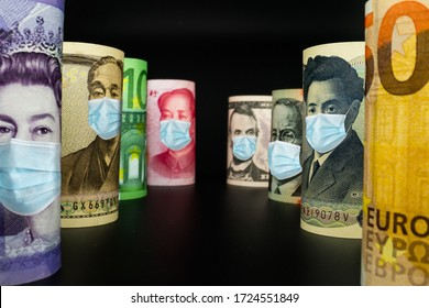 International currency money include US American Dollar, Euro Currency, British UK Pound, Australian Dollar, China Yuan and Japan Yen face mask concept of coronavirus disease COVID-19 economic crisis.