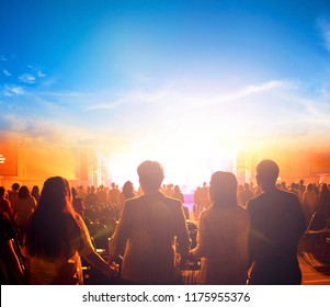 International Day of Peace:Silhouette of man raised hands at autumn sunset meadow background