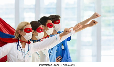 International doctor and nurse team wearing surgical face mask in superhero cape. Medical staff during coronavirus outbreak. Super hero power for clinic and hospital personal. Covid-19 pandemic.