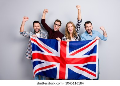 International ethnicity language learn course university concept. Friendly excited cheerful guys screaming rejoicing putting fists up triumphing holding jack union flag isolated on gray background