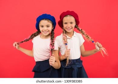International exchange school program. Education abroad. Apply form enter international school. French language school. School fashion concept. Pupil smiling girls wear formal uniform and beret hats.