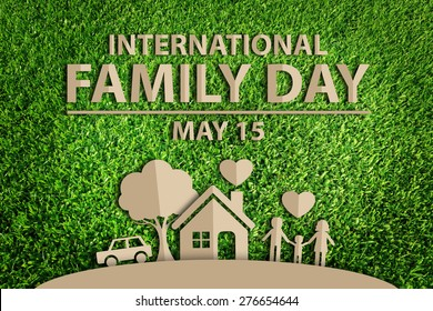 International Family day concept. Paper cut of family on green grass.