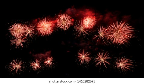 International fireworks festival display at night. Variety of colorful fireworks in holidays celebration isolated on black. Happy New Year Background.