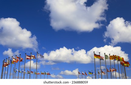 international flags on a background of clouds