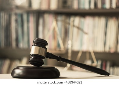 International human rights day concept: Judge gavel with scales on library