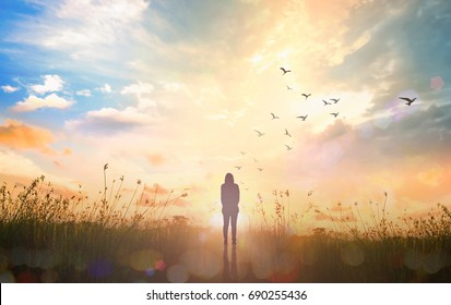 International human rights day concept: Silhouette alone woman standing on abstract of heaven background