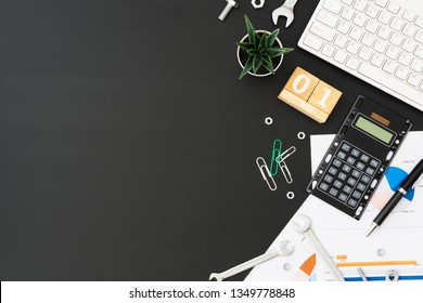 International Labour's day or worker's day background concept. Office or home table desk with Wooden cubes calendar May 1st, wireless keyboard, calculator, succulent, wrenches, nuts and bolts on table