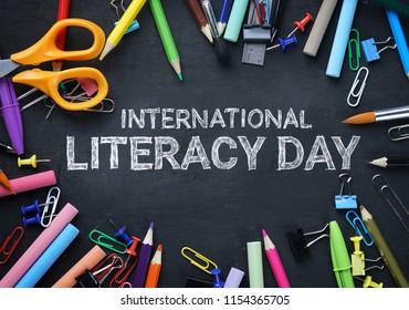 International Literacy Day. School Stationary Top View on Blackboard